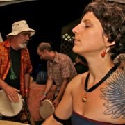 Tattooed woman in drum Jam @ Shaw Percussion Tent